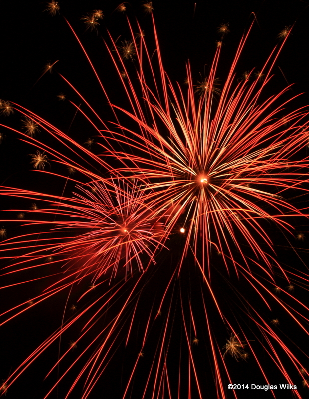 A longer exposure of several fireworks bursts that happened within seconds of one another.